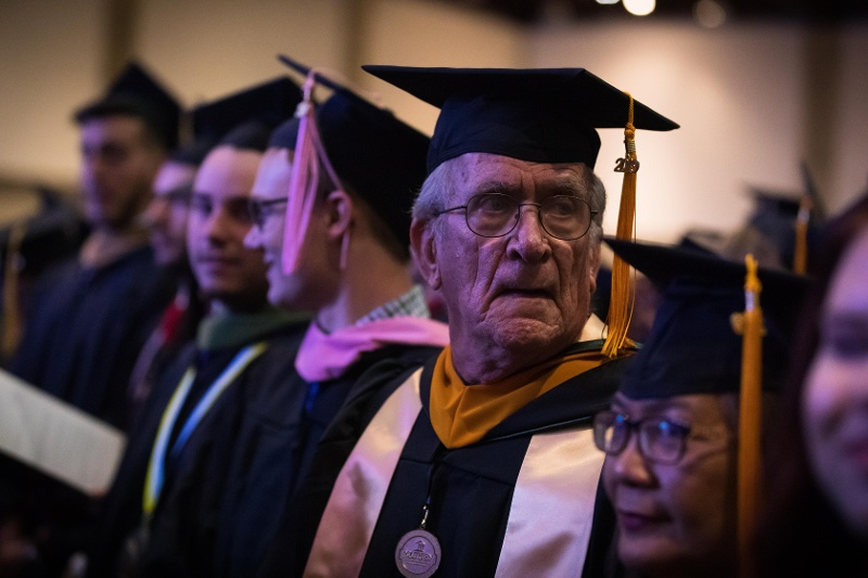 older male student at college graduate